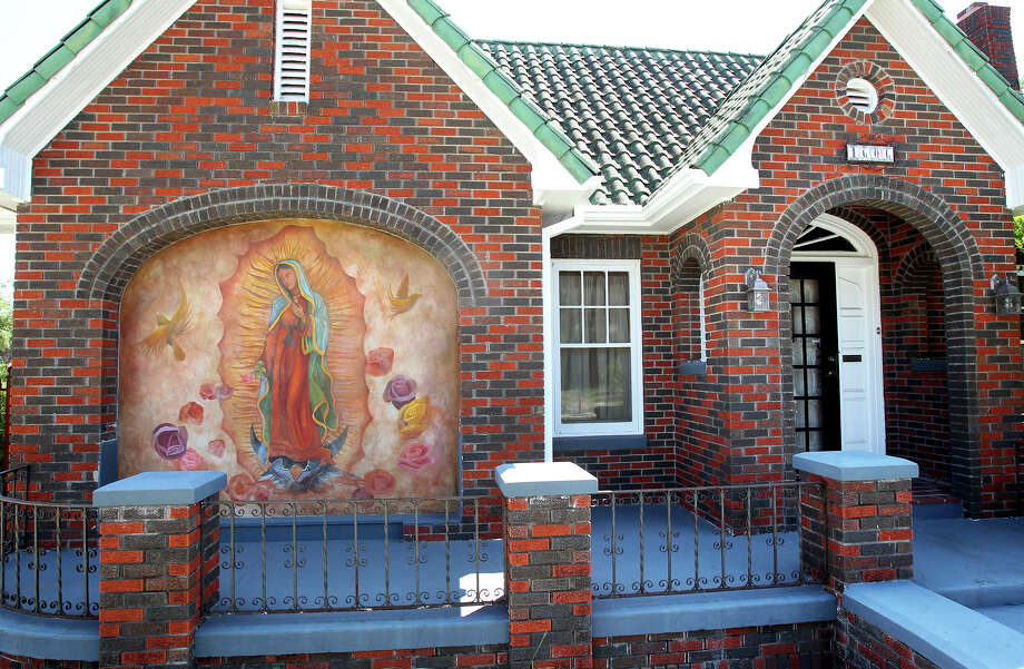 Toni Durr had a mural of the Virgin Mary painted on the front of her home when she remodeled to make a TV room. Photo: Tom Reel, San Antonio Express-News / ©2012 San Antono Express-News