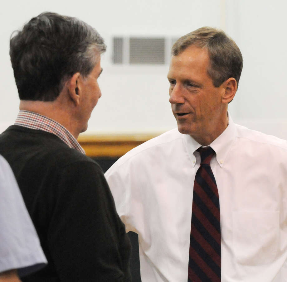 Sen. Neil Breslin, left, chats with Bethlehem Supervisor John Clarkson, right, at Bethlehem Town Hall in Delmar N.Y. where Sen. Breslin voted in Thursday's primary, Sep. 13, 2012. (Will Waldron / Times Union) Photo: Will Waldron