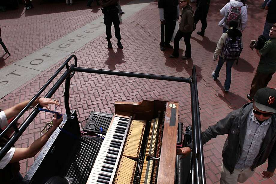 Kirby Lee Hammel and Jacob Alexander unload their upright piano and drum set at the Heart of the City Famers'  Market before performing as the musical duo know Clangin' and Bangin' in San Francisco, Calif. Photo: Mike Kepka, The Chronicle