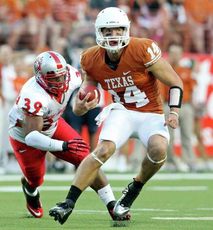 Texas Longhorns' David Ash looks for running room around New Mexico Lobos' Joe Stoner during first half action Saturday Sept. 8, 2012 at Texas Memorial Stadium in Austin, Tx. Photo: Edward A. Ornelas, San Antonio Express-News / © 2012 San Antonio Express-News