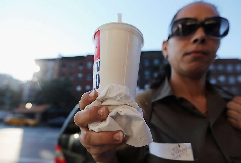 "NEW YORK, NY - SEPTEMBER 13:  Jasmine Batista displays a 21-ounce soda she purchased at McDonalds in Manhattan after the New York City Board of Health voted to ban the sale of large sugary drinks at restaurants and concessions on September 13, 2012 in New York City. Batista said once the ban goes in effect she will purchase 2-liter soda bottles from businesses that aren't affected by the ban. Batista said, ""I can't stand people telling me what I can drink."" The controversial measure bars the sale of sugar drinks larger than 16 ounces in an effort to combat obesity. (Photo by Mario Tama/Getty Images) Photo: Mario Tama, Getty Images"