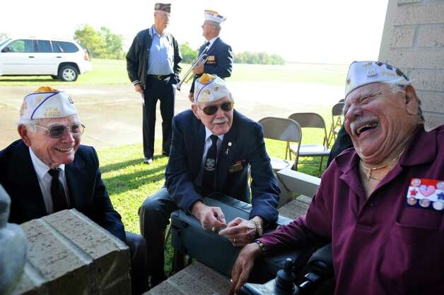 WWII veterans from VFW Post 4820 in Port Neches, Otis Barnes, left, Robert Dill, center, and Felix Solis, right, share a laugh prior to the start of the Veterans Day Celebration at Golden Triangle Veterans Memorial Park on Wednesday, November 11, 2009. Valentino Mauricio/The Enterprise Photo: Valentino Mauricio / Beaumont