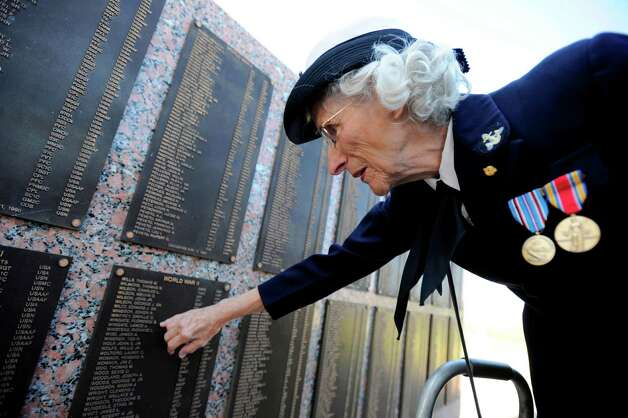 Florence Wingate, who was a Yeoman Wave in WWII, finds her name along with her deceased husband's name, Lance Wingate, on the Veterans Wall of the Golden Triangle Veterans Memorial Park during the Veteran's Day Celebration on Wednesday, November 11, 2009. Valentino Mauricio/The Enterprise Photo: Valentino Mauricio / Beaumont