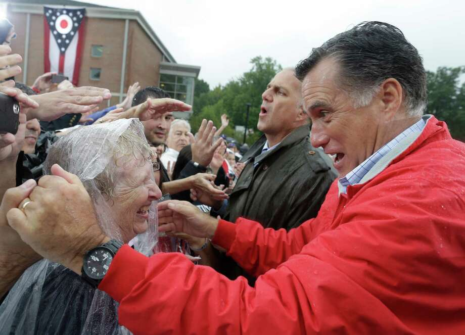 GOP presidential candidate Mitt Romney campaigns in the rain at Lake Erie College in Painesville, Ohio. Voters in California, Texas and New York hope to boost turnout in key swing states. Photo: Charles Dharapak, Associated Press / AP