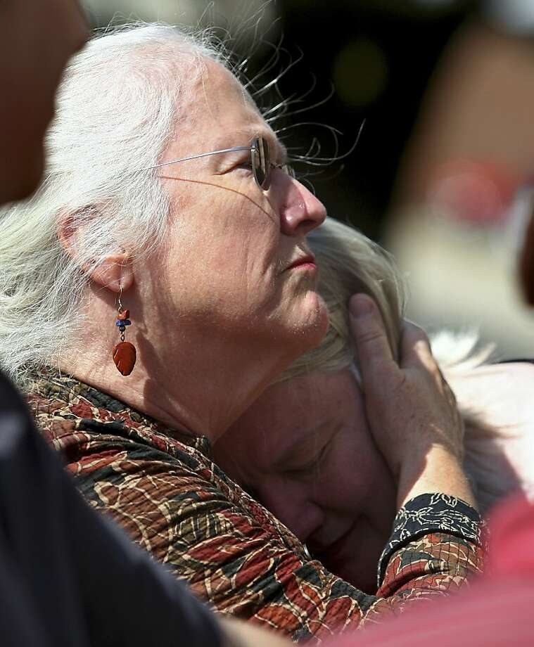 Jeanne Tessier (left) hugs sister Janet after their half brother's conviction. Photo: Kyle Bursaw, Associated Press