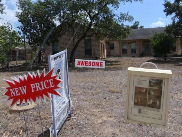 A home for sale on Evans Road just east of Bulverde Road on Wednesday, Sept. 12, 2012. (San Antonio Express News)