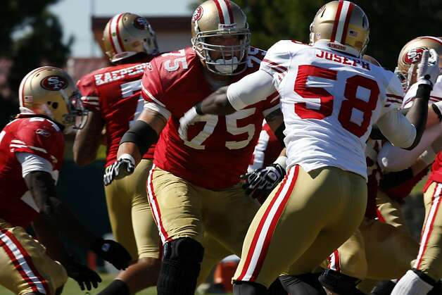 San Francisco 49ers offensive tackle Alex Boone, number 75, blocks linebacker Alex Joseph, number 58, during a drill at the 49ers training camp in Santa Clara Calif.,  on August 16, 2011. Photo: Audrey Whitmeyer-Weathers, The Chronicle