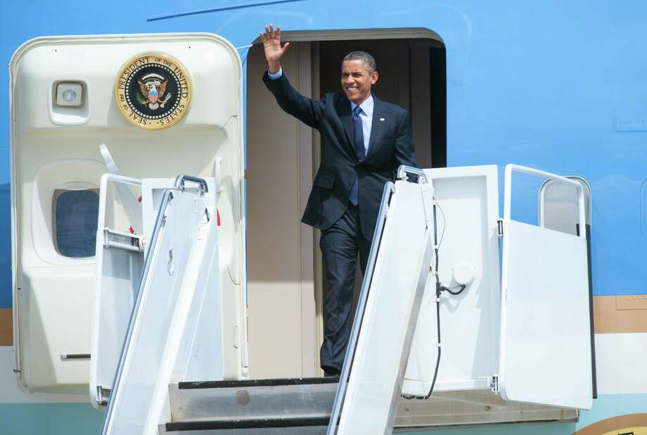 President Barack Obama waves as he steps off of Air Force One upon his arrival in San Antonio on Tuesday, July 17, 2012. Photo: Bahram Mark Sobhani, Associated Press / FR91484 AP