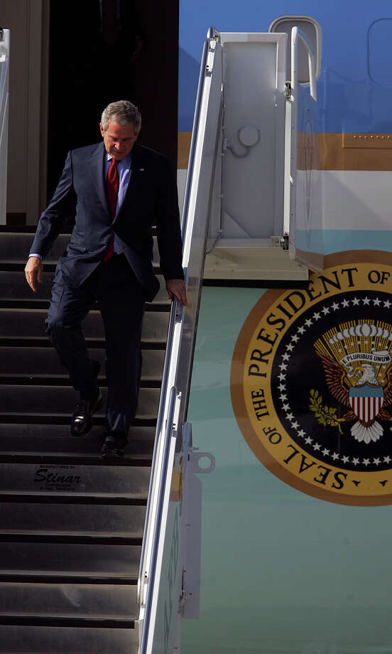 President George W. Bush steps off Air Force One at San Antonio International Airport as he arrives for a day visit to San Antonio on Thursday, Nov. 8, 2007. Photo: Bahram Mark Sobahani, San Antonio Express-News File Photo / SAN ANTONIO EXPRESS NEWS
