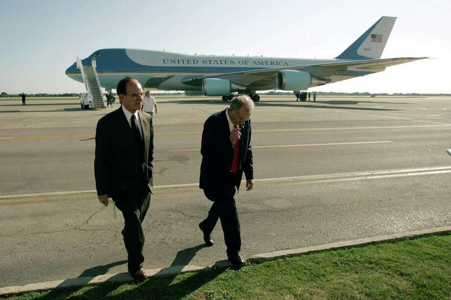 County Judge Nelson Wolff (left) and San Antonio Mayor Phil Hardberger walk toward the media Sunday, Sept. 25, 2005, at Randolph AFB in San Antonio after riding with President George W. Bush in his motorcade before Bush boarded Air Force One on his way to Baton Rouge, La. Photo: William Luther, San Antonio Express-News File Photo / SAN ANTONIO EXPRESS-NEWS