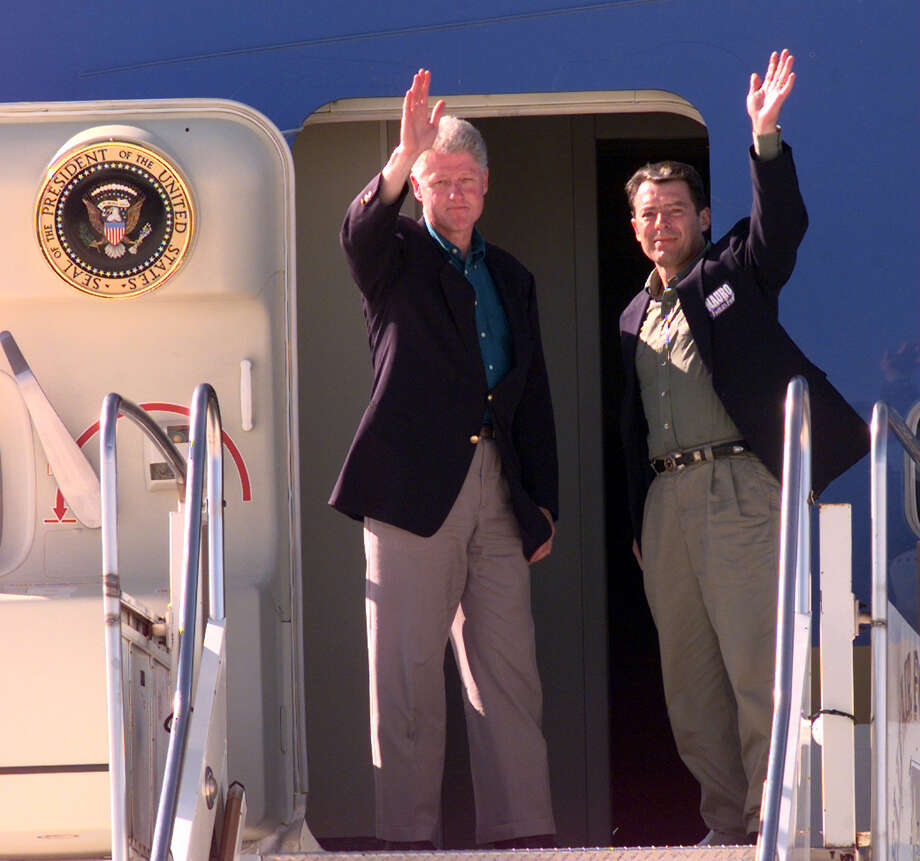 President Bill Clinton and Texas gubernatorial candidate Garr Mauro wave while boarding Air Force One in San Antonio on their way to Houston on Sept. 27, 1998. Photo: Rick Hunter/ Express-News File Photo
