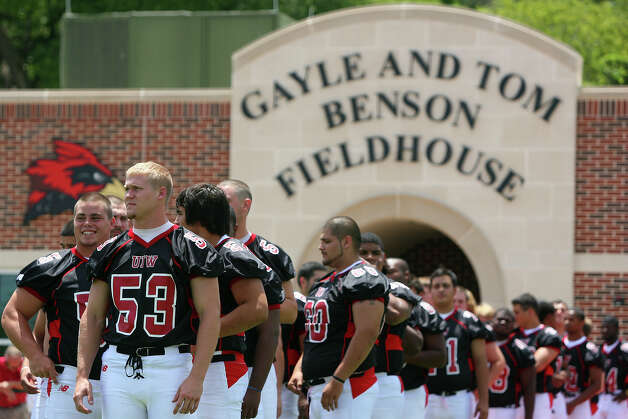 Players wait on the field to be organized for the 2010 team photo at UIW football media day at Benson Field House, Sunday, August 8, 2010. Photo: JENNIFER WHITNEY, Express-News / special to the Express-News