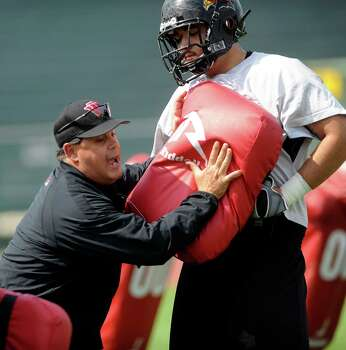Tony Marciano, a coach with NFL ties, works his his linemen during football practice at the University of the Incarnate Word on Tuesday, April 20, 2010. BILLY CALZADA / gcalzada@express-news.net Photo: BILLY CALZADA, Express-News / gcalzada@express-news.net