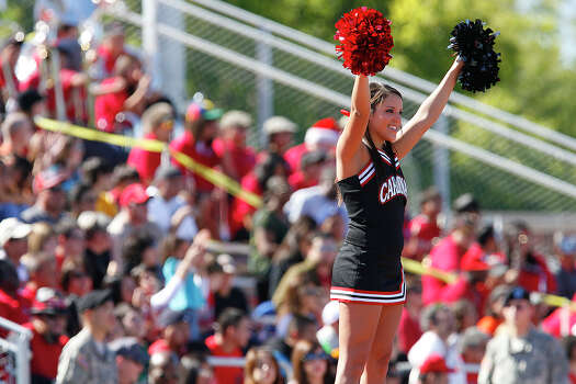 An Incarnate Word cheerleader gets hoisted above the crowd to cheer the Cardinals on against Southern Arkansas Muleriders at Benson Stadium on Saturday, Oct. 31, 2009. Photo: Kin Man Hui, Express-News / San Antonio Express-News