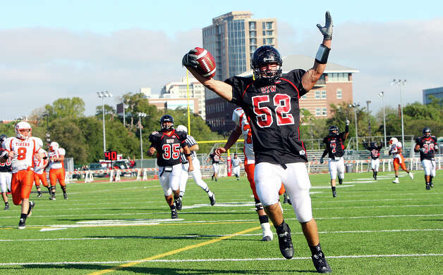 University of the Incarnate Word's Alan Ford celebrates as he scores a touchdown on a fumble recovery against East Central Oklahoma during second half action Saturday Oct. 10, 2009 at Benson Stadium. Incarnate Word won 38-20. Photo: EDWARD A. ORNELAS, Express-News / eaornelas@express-news.net