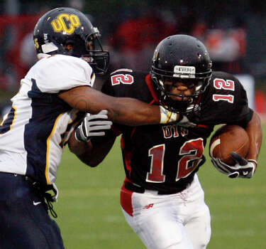 Incarnate Word's Stan Sullivan takes on Central Oklahoma's Randy Stanley during game action at Benson Stadium on Saturday, Sept. 18, 2010. Incarnate Word won in overtime, 42-41.  Photo: MICHAEL MILLER, Express-News / mmiller@express-news.net