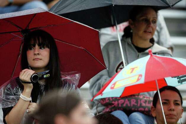 Incarnate Word fans brave the rain during game action against Central Oklahoma at Benson Stadium on Saturday, Sept. 18, 2010. Incarnate Word won in overtime, 42-41.  Photo: MICHAEL MILLER, Express-News / mmiller@express-news.net