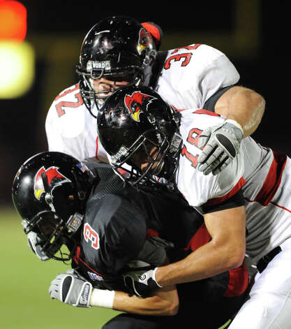 Incarnate Word's Matt Bass (32) and Glenn Hill (18) tackle Dominic Hamilton (3) during the UIW annual Black vs Red spring football game at Benson Stadium in San Antonio, Texas on April 14, 2011. Photo: JOHN ALBRIGHT, Express-News / San Antonio Express-News