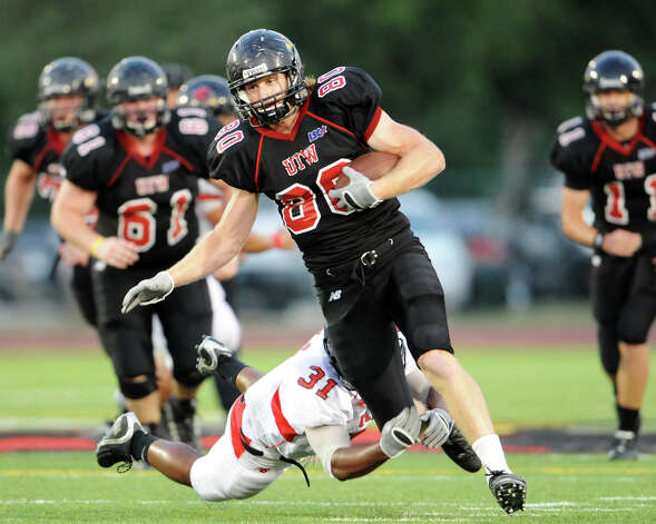 Incarnate Word tight end Andrew Mocio (80) is tackled by Aaron Stokes (31) after making a reception during the UIW annual Black vs Red spring football game at Benson Stadium in San Antonio, Texas on April 14, 2011. Photo: JOHN ALBRIGHT, Express-News / San Antonio Express-News