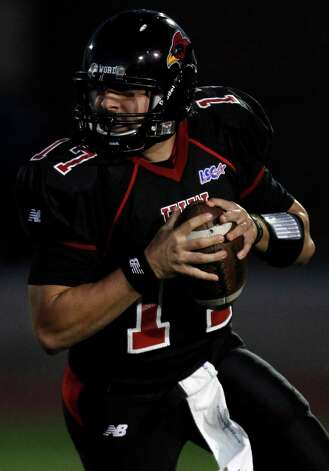 Incarnate Word's Thomas Specia looks to throw during game action against Abilene Christian at Benson Stadium on Saturday, Oct. 16, 2010. Abilene Christian won 54-17.  Photo: MICHAEL MILLER, Express-News / mmiller@express-news.net