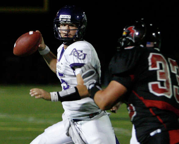 Abilene Christian's Mitchell Gale looks to pass as Incarnate Word's Dakota Mawyer gives chase during game action at Benson Stadium on Saturday, Oct. 16, 2010. Photo: MICHAEL MILLER, Express-News / mmiller@express-news.net
