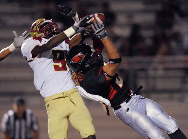 Devin Haywood of the University of the Incarnate Word, right, intercepts a pass meant for Edgard Theliar (9) of Midwestern State during college football action at Benson Stadium on Saturday, Oct. 1, 2011.  Photo: BILLY CALZADA, Express-News / gcalzada@express-news.net