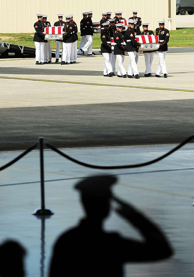 In a ceremony at Andrews Air Force Base in Maryland, Marines carry the caskets of the U.S. diplomatic personnel killed in Benghazi, Libya. Photo: Jewel Samad, AFP/Getty Images