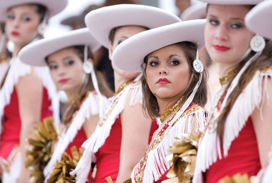 Cy Woods dance team marches into the stadium before their homecoming game against Langham Creek at Pridgeon Stadium on Friday, Sept. 14, 2012, in Houston. Photo: Joe Buvid, For The Chronicle / © 2012 Joe Buvid