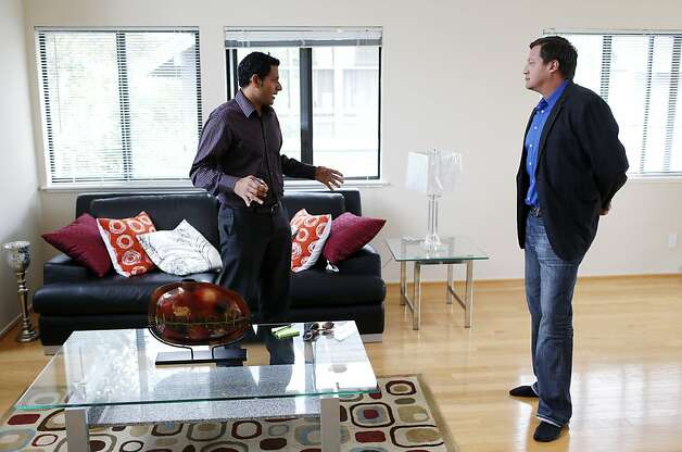 Redfin field agent Maurice Sandoval (right) talks with home buyer Akil Murali, of Palo Alto, while touring a house, September 14, 2012 in Foster City, Calif. Photo: Beck Diefenbach, Special To The Chronicle