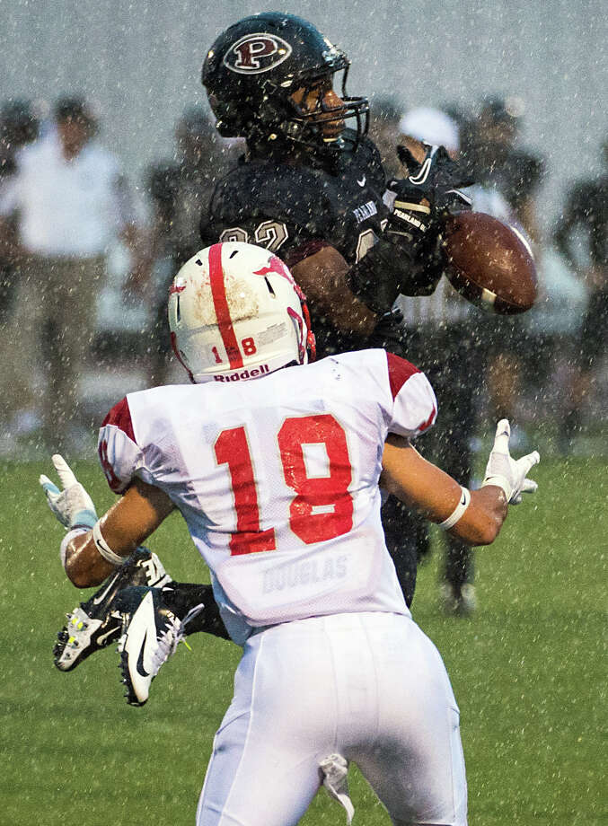Pearland defensive back Emry Flanagan (22) breaks up a pass intended for Memorial wide receiver Ryan Baumgartner (18) during the first quarter of a high school football game at The Rig on Friday, Sept. 14, 2012, in Pearland. Photo: Smiley N. Pool, Houston Chronicle / © 2012  Houston Chronicle