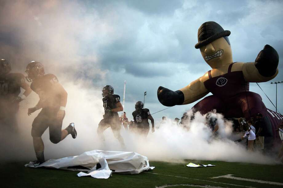 Pearland take the field before a high school football game against Memorial at The Rig on Friday, Sept. 14, 2012, in Pearland. Photo: Smiley N. Pool, Houston Chronicle / © 2012  Houston Chronicle
