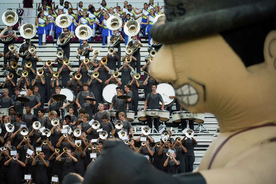The Pearland band performs before their team faces Memorial in a high school football game at The Rig on Friday, Sept. 14, 2012, in Pearland. Photo: Smiley N. Pool, Houston Chronicle / © 2012  Houston Chronicle