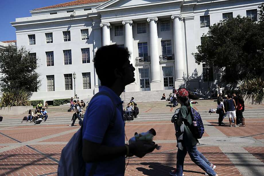 Students pass Sproul Hall as they walk to classes at UC Berkeley. No raise in tuition is on the table, but that will occur if a ballot proposition doesn't pass. Photo: Michael Short, Special To The Chronicle
