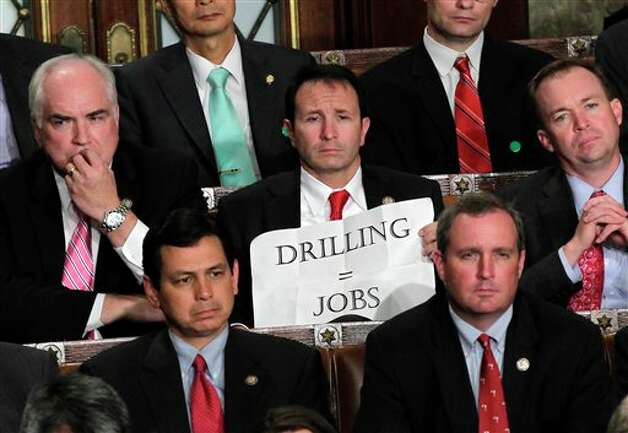 Rep. Jeff Landry, R-La., holds a sign during a speech by President Barack Obama to a joint session of Congress at the Capitol in Washington, Thursday, Sept. 8, 2011.  (AP Photo/J. Scott Applewhite) Photo: J. Scott Applewhite, AP / AP