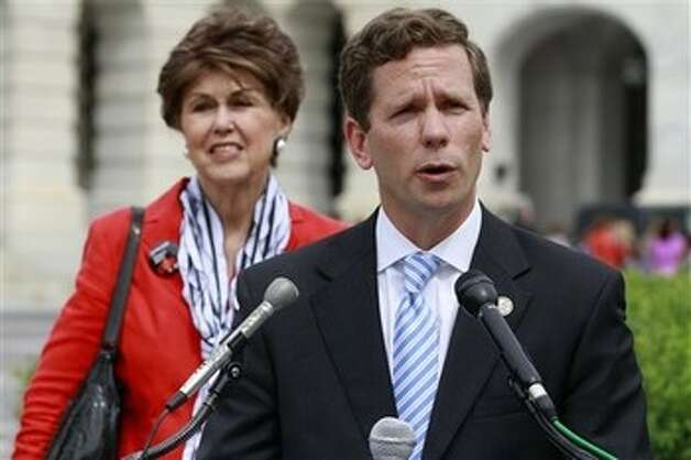 Rep. Robert Dold, R-Ill., right, accompanied by Darlee Crockett, national co-chair of Republicans for Choice of the Planned Parenthood Federation of America, speaks during a news conference on Capitol Hill in Washington, Wednesday, May 9, 2012, to discuss women's health care. (AP Photo/Jacquelyn Martin) Photo: Jacquelyn Martin, AP / AP