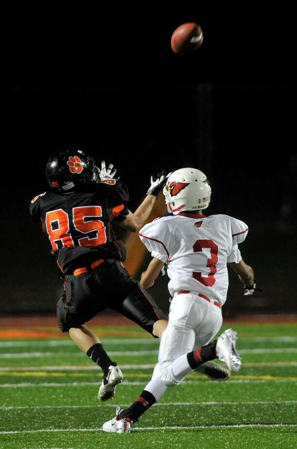 Ridgefield's Timo Muro dives for a reception while under pressure from Greenwich's Austin Longi during their game at Ridgefield High School on Friday, Sept. 14, 2012. Photo: Jason Rearick / The News-Times