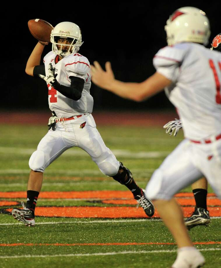 Greenwich's Jose Melo looks to Alex McMurray for a pass during their game against Ridgefield at Ridgefield High School on Friday, Sept. 14, 2012. Photo: Jason Rearick / The News-Times