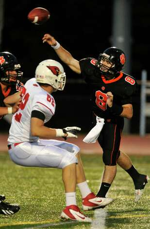 Ridgefield quarterback Connor Rowe throws the ball during their game against Greenwich at Ridgefield High School on Friday, Sept. 14, 2012. Photo: Jason Rearick / The News-Times