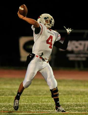 Greenwich quarterback Jose Melo throws the ball during their game against Ridgefield at Ridgefield High School on Friday, Sept. 14, 2012. Photo: Jason Rearick / The News-Times