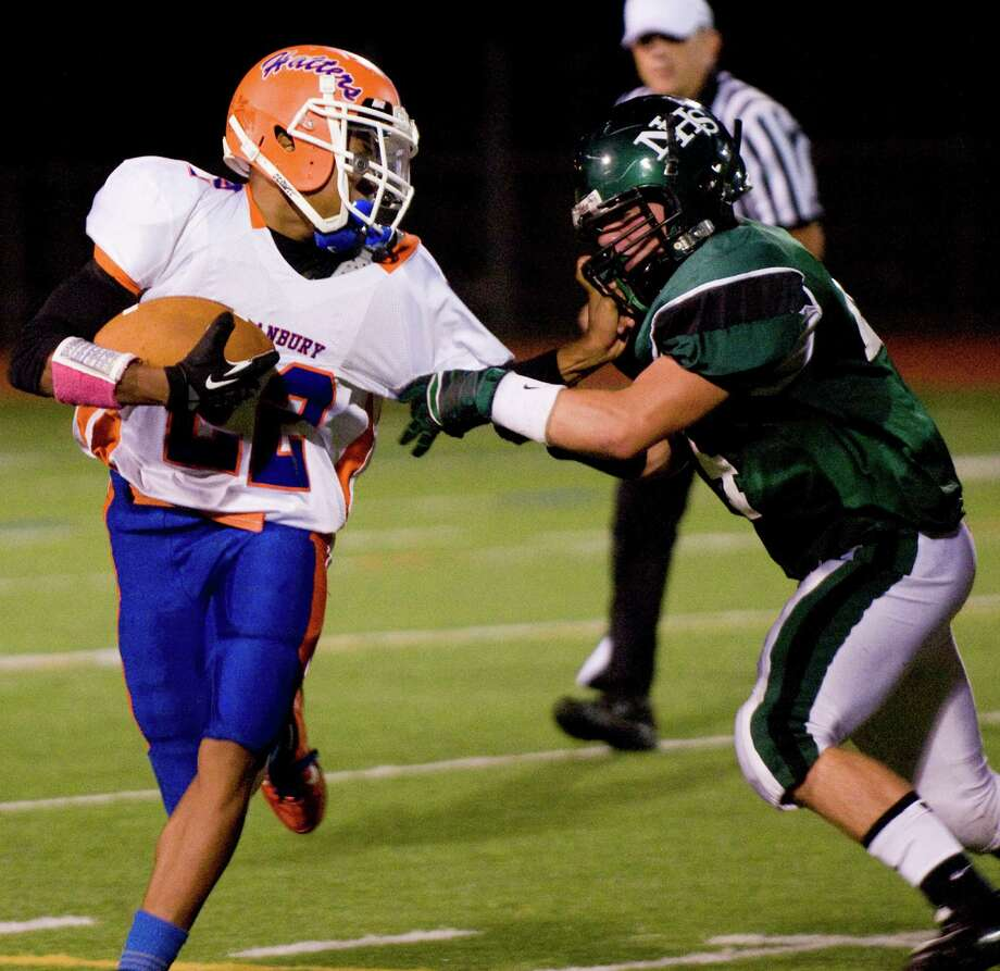 Danbury's Tysheen McCrea and Norwalk's James McInerney face off as Norwalk High School hosts Danbury in a football game Friday, Sept. 14, 2012. Photo: Keelin Daly / Stamford Advocate Freelance