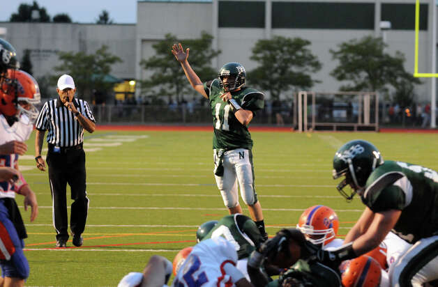 Norwalk's Jared Smith reacts to the team's first touch down as Norwalk High School hosts Danbury in a football game Friday, Sept. 14, 2012. Photo: Keelin Daly / Stamford Advocate Freelance