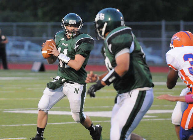 Bears quarterback Jared Smith in action as Norwalk High School hosts Danbury in a football game Friday, Sept. 14, 2012. Photo: Keelin Daly / Stamford Advocate Freelance