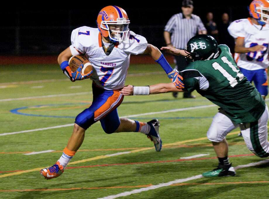 Danbury's Corey Chaffee runs the ball as he fends off Norwalk's Jared Smith as Norwalk High School hosts Danbury in a football game Friday, Sept. 14, 2012. Photo: Keelin Daly / Stamford Advocate Freelance