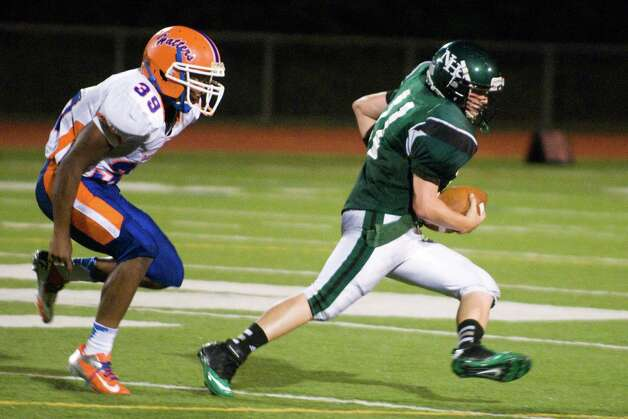 Norwalk quarterback Jared Smith fells the pressure from Danbury's defense as Norwalk High School hosts Danbury in a football game Friday, Sept. 14, 2012. Photo: Keelin Daly / Stamford Advocate Freelance