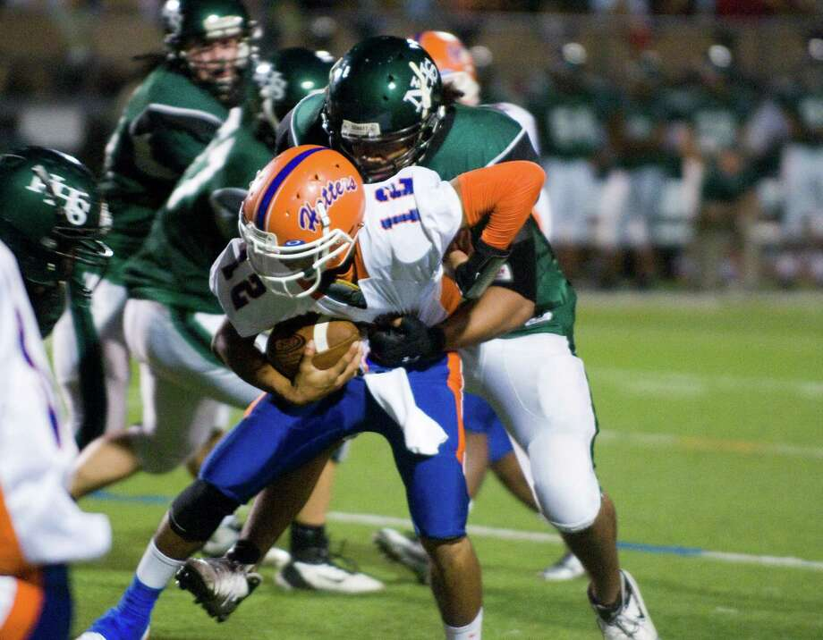 Danbury's Anferny Ith is sacked as Norwalk High School hosts Danbury in a football game Friday, Sept. 14, 2012. Photo: Keelin Daly / Stamford Advocate Freelance