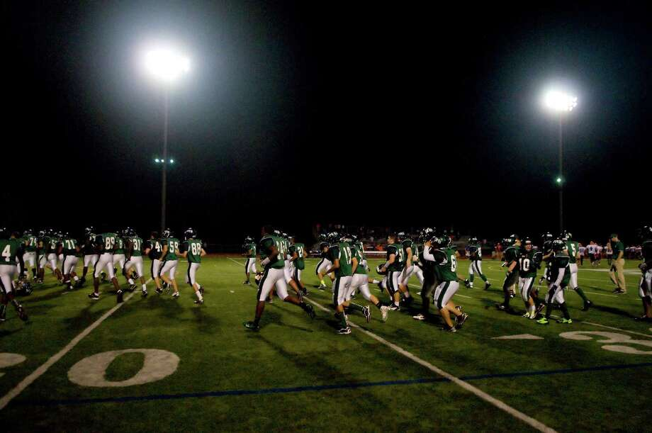 The Bears leave the field at halftime Norwalk High School hosts Danbury in a football game Friday, Sept. 14, 2012. Photo: Keelin Daly / Stamford Advocate Freelance