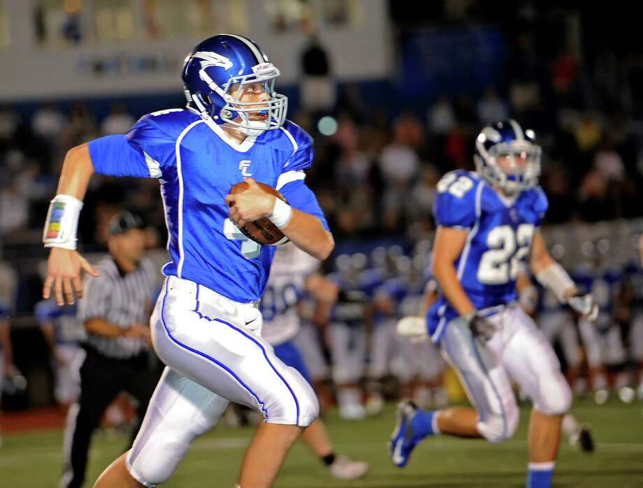Fairfield Ludlowe high school quarterback Peter Cross moves the ball upfield against Darien high school in the first football game of the 2012 season held at Fairfield Ludlowe high school, Fairfield, CT on Friday September 14th 2012 Photo: Mark Conrad / Connecticut Post Freelance