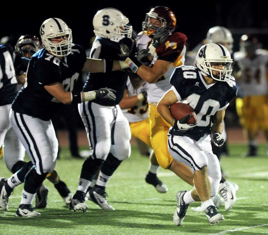 Staples' Zach Speranza carries the ball during Friday's game against St. Joseph High School at Staples High School in Westport on September 14, 2012. Photo: Lindsay Niegelberg / Stamford Advocate