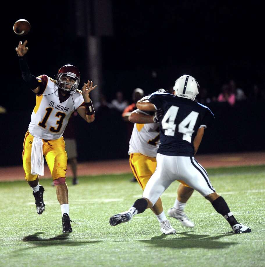 St. Joseph's Jordan Vazzano passes the ball during Friday's game at Staples High School in Westport on September 14, 2012. Photo: Lindsay Niegelberg / Stamford Advocate