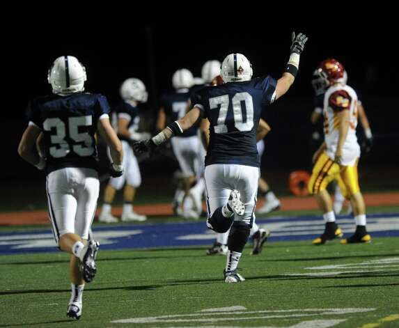 Staples players celebrate a touchdown during Friday's game against St. Joseph at Staples High School in Westport on September 14, 2012. Photo: Lindsay Niegelberg / Stamford Advocate